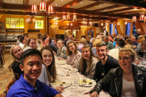 High School French Exchange students at dinner