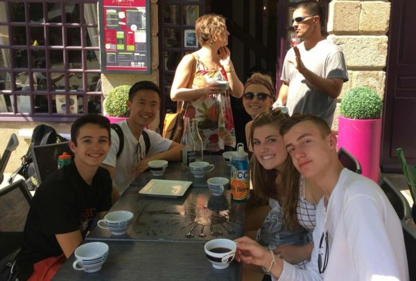 Haolan and his American classmates enjoying a coffee during their French Exchange en Rennes.
