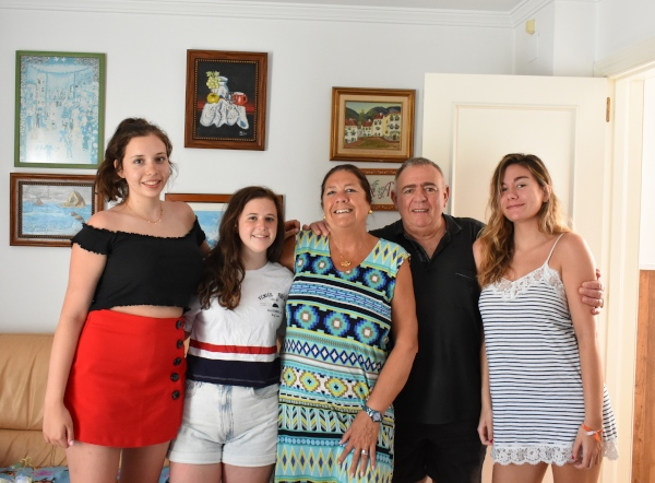 Host mother Ana and her family with visiting American students.