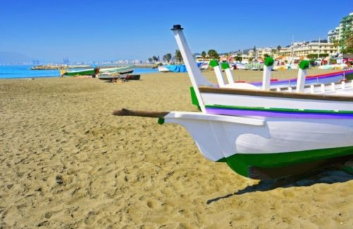 Boats on beach of Malaga neighborhood