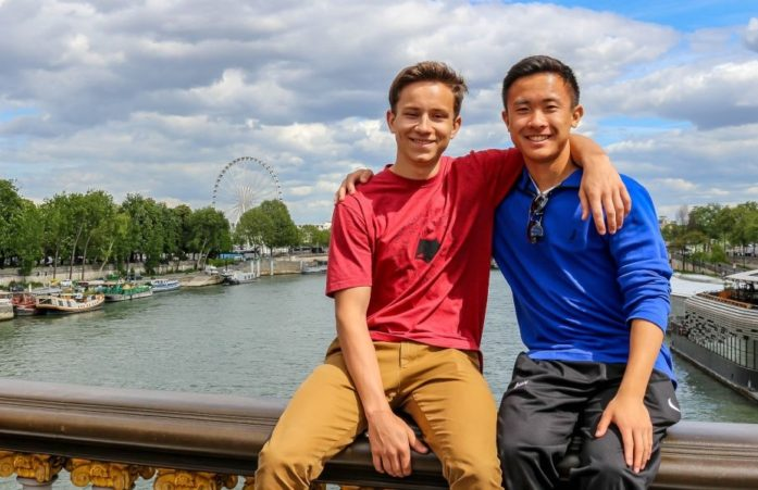 Haolan and classmate sitting on the Pont Alexandre III in Paris.