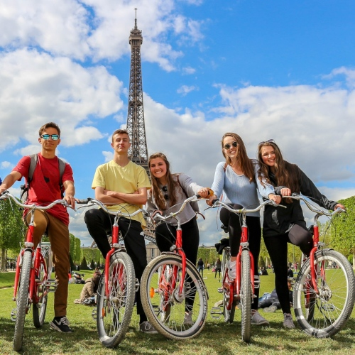 Bike tour in Paris in front of Eiffel Tower high school French exchange